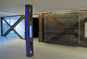 Exposicion con Pared hecha en vigas de hierro. Portafolio de proyectos de interiorismo en Barcelona Interior Studio