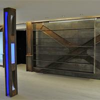 Exposicion con Pared hecha en vigas de hierro - Portafolio de proyectos de interiorismo y rehabilitación en Barcelona Interior Studio